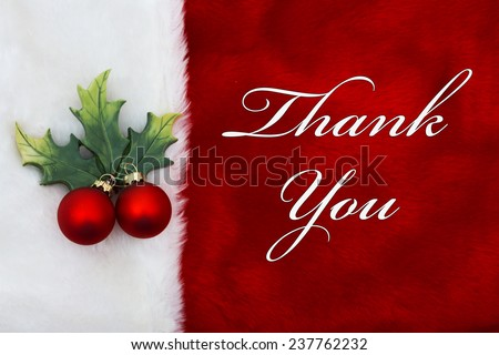 Thank You, A plush red stocking with a Mistletoe Ornament and words Thank You - stock photo