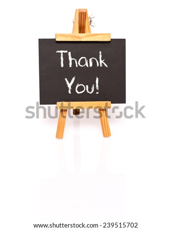 Thank You. Blackboard with text and easel. Photo on white background with shadow and reflection. - stock photo