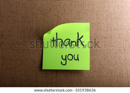 Thank you - colorful sticky notes with handwriting on cork bulletin board. - stock photo