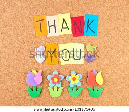 Thank you, conceptual words with decoration on cork - stock photo