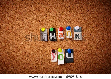 Thank you - Cut out letters pinned on a notice board. - stock photo