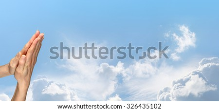 Thank you for this beautiful day - Female hands in prayer position on a gorgeous wide blue sky background with plenty of copy space - stock photo