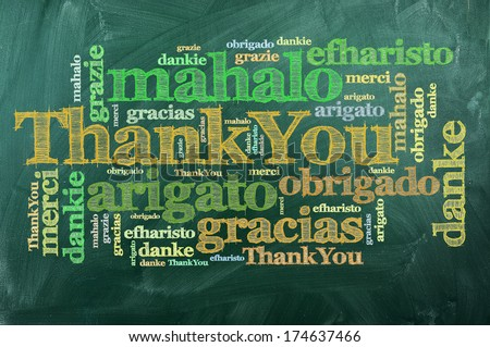 thank you in different languages on green chalkboard - stock photo