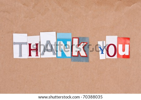 Thank you, letters sorted on paper background - stock photo