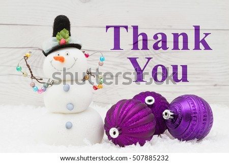Thank you message, Some snow, Christmas ornaments and a snowman on weathered wood with text Thank You