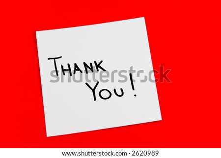 Thank you note isolated on red background - stock photo