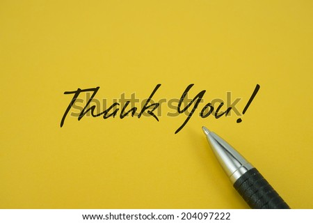 Thank You! note with pen on yellow background