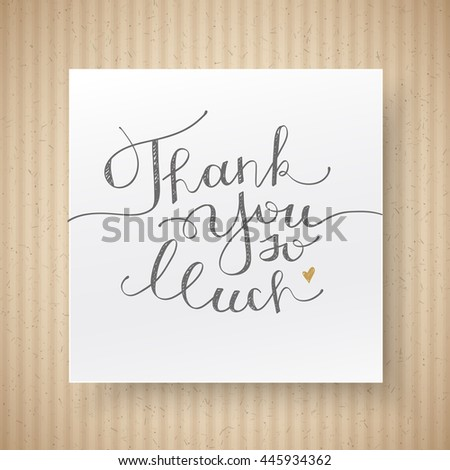 thank you so much, handwritten lettering on cardboard texture and paper page - stock photo