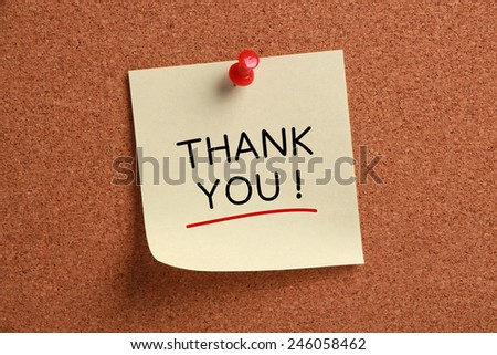 Thank you sticky note pinned on cork board. - stock photo