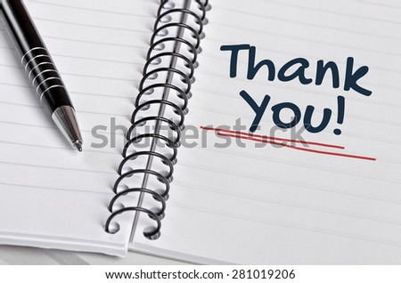Thank You word on notebook page - stock photo