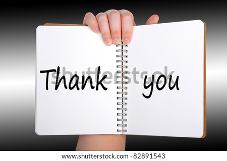 Thank you words on book - stock photo