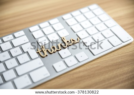 Thanks Message on Computer Keyboard with Shallow Depth of Field Focused on Message - stock photo