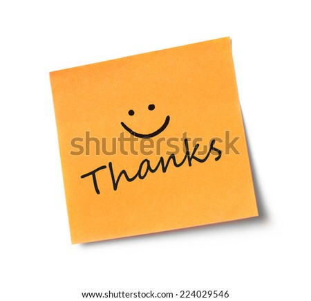 Thanks on adhesive note Adhesive note on white background - stock photo
