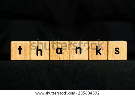 thanks wood Cubic on black background - stock photo