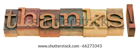 thanks - word in vintage wooden letterpress printing blocks isolated on white - stock photo