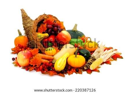 Thanksgiving cornucopia filled with fresh harvest vegetables  - stock photo