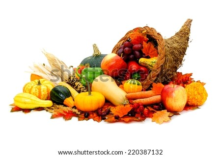 Thanksgiving cornucopia filled with fresh harvest vegetables - stock photo