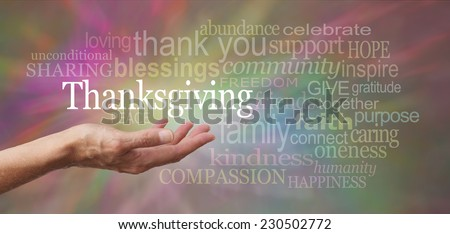 Thanksgiving Day Blessings - Female hand outstretched with palm side up and a white 'Thanksgiving' word floating above surrounded by words related to Thanksgiving theme on a multicolored background - stock photo
