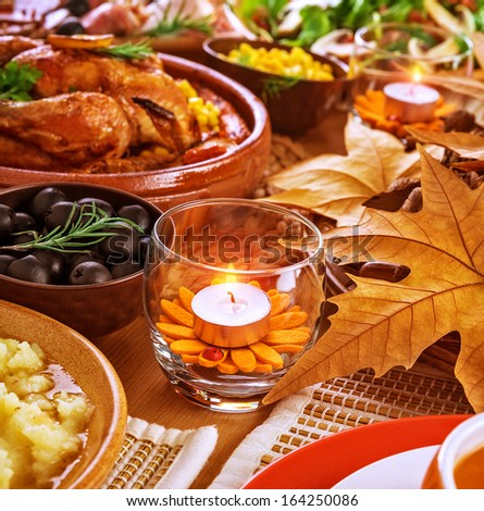 Thanksgiving day menu, traditional oven roasted chicken, different kind of tasty food, beautiful autumn decoration, festive meal concept - stock photo