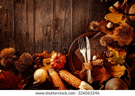 Thanksgiving dinner. Autumn fruit with plate and cutlery. Thanksgiving autumn background - stock photo