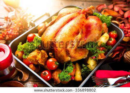 Thanksgiving Dinner. Roasted turkey garnished with Potato, Vegetables and cranberries on a rustic style table decorated with autumn leaves and candles. Christmas Dinner. Served table, table setting  - stock photo