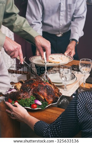 Thanksgiving: Father Carving Up Holiday Turkey - stock photo
