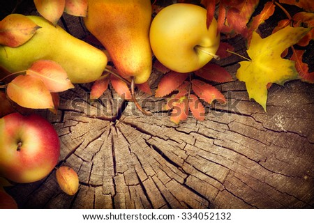 Thanksgiving frame background. Autumn Fall background with colorful leaves, apples and pears, Beautiful vintage styled autumn fruits and colorful leaves over wooden table - stock photo