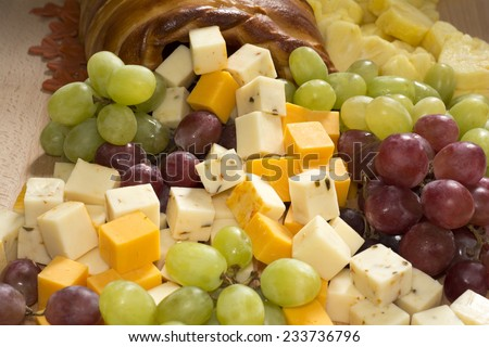 Thanksgiving Fruits and Cheeses Cornucopia  Bread on Wooden Board - stock photo