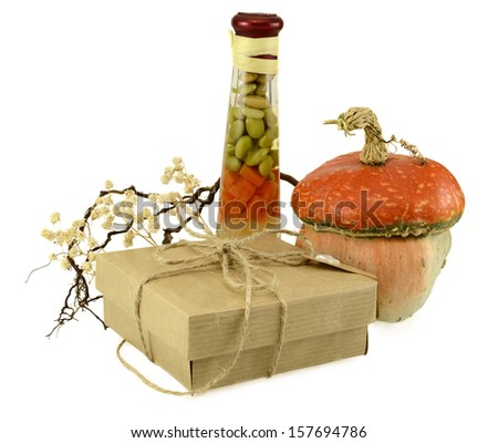 Thanksgiving gift with unusual pumpkin and conservation isolated on white - stock photo