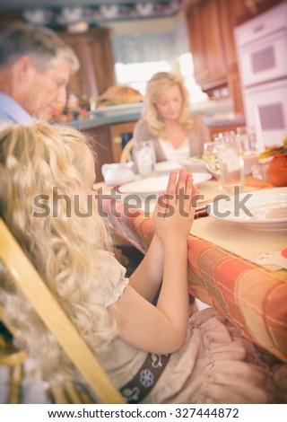 Thanksgiving: Little Girl Has Hands Together While Having Dinner Blessing - stock photo
