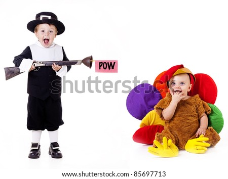 Thanksgiving; Pilgrim child pretending to shoot baby dressed in silly turkey costume with a toy rifle - stock photo