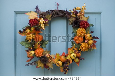 Thanksgiving wreath hanging on residential door - stock photo
