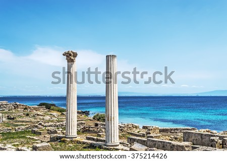 Tharros columns on a clear day, Sardinia - stock photo