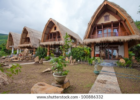 Thatch roof bungalow on the north east coast of Bali, Indonesia. - stock photo