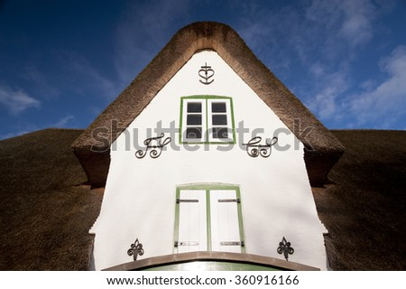 Thatched Roof House on Amrum in Germany - stock photo