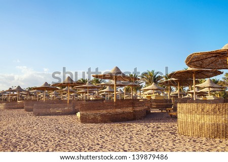 thatched umbrellas on the shore
