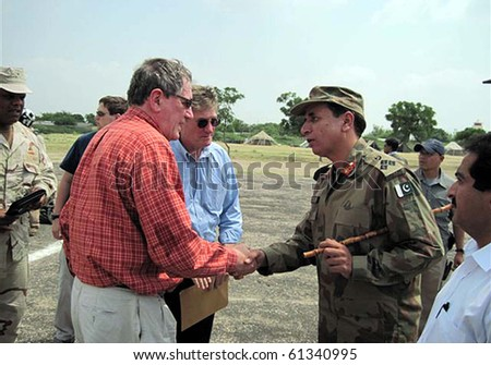 THATTA, PAKISTAN-SEPT 16: US.Special Rep. for Afghanistan and Pakistan, Ambassador Richard C.Holbrooke shakes hand with Army Brig.Mehmood during his visits at Army IDPs camp Sept 16, 2010 in Thatta