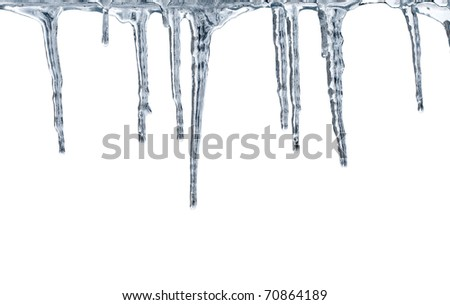 Thawing icicles isolated on white background - stock photo