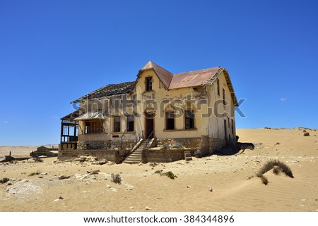 The abandoned ghost diamond town of Kolmanskop in Namibia, which is slowly being swallowed by the desert