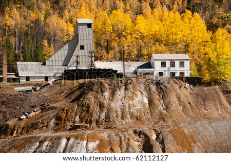 The Abandoned Mine In Golden Aspens - stock photo