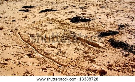 The Aboriginal flag drawn in the sand at Port Willunga (Adelaide, Australia). - stock photo