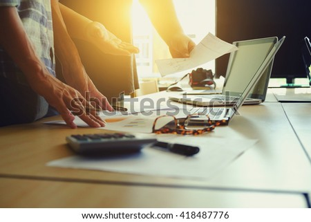 The above view of young man discussing data at meeting - stock photo