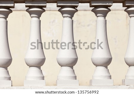 the abstract background of white plaster columns - stock photo