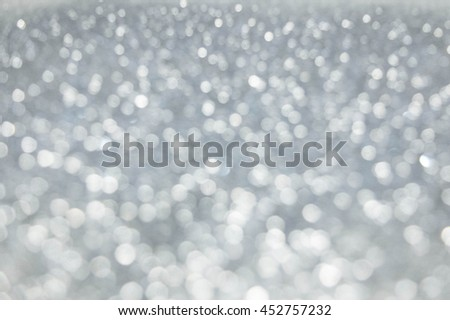 The Abstract blur silver bokeh lighting from glitter texture. Luxury design background.