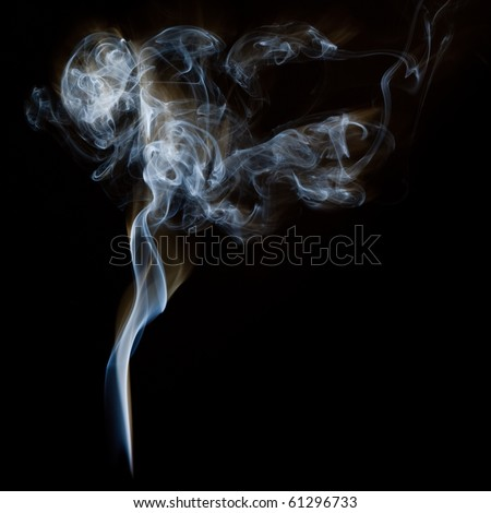 The abstract figure of the smoke on a black background - stock photo