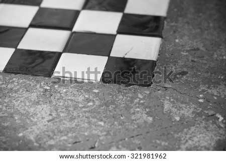 The abstract image of chess board on the table that capture at the corner(black and white theme) - stock photo