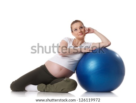 The active pregnant woman does sports exercises on a white background. Care of health and pregnancy. - stock photo