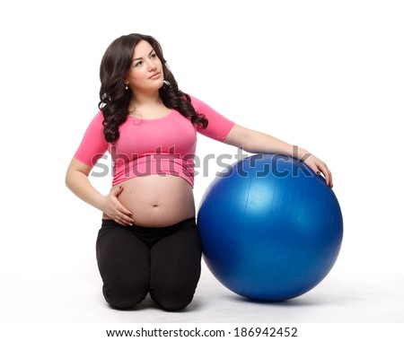 The active pregnant woman with gymnastic ball on a white background. Care of health and pregnancy.