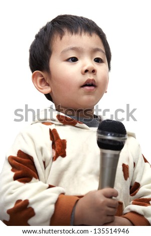 The adorable toddler singer boy with a microphone.