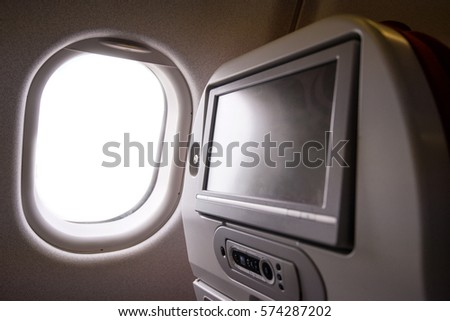 the aeroplane window with white light outside